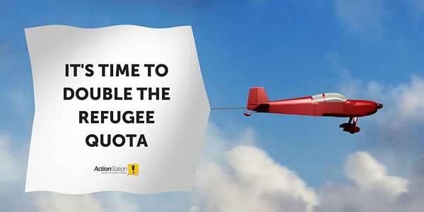 Plane with a banner that says: It's time to double the refugee quota