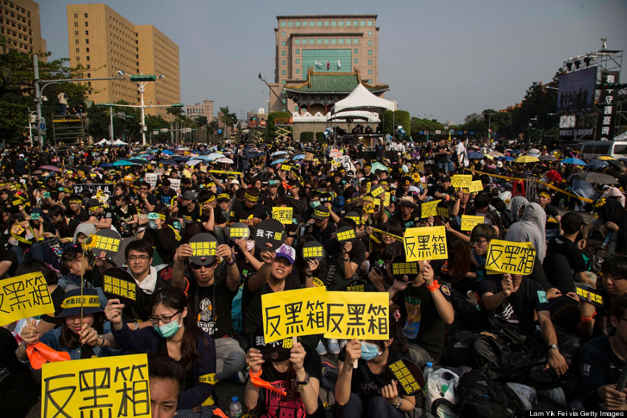 TAIPEI, TAIWAN - MARCH 30: Protestors holds signs as over two hundred thousand people rally on March 30, 2014 in Taipei, Taiwan. Taiwanese student protesters opposing the contentious cross-strait service trade agreement with China called for a huge weekend rally filling Ketagalan Boulevard leading from the Presidential Office to the Legislature Yuan to increase pressure on President Ma Ying-jeou. (Photo by Lam Yik Fei/Getty Images)