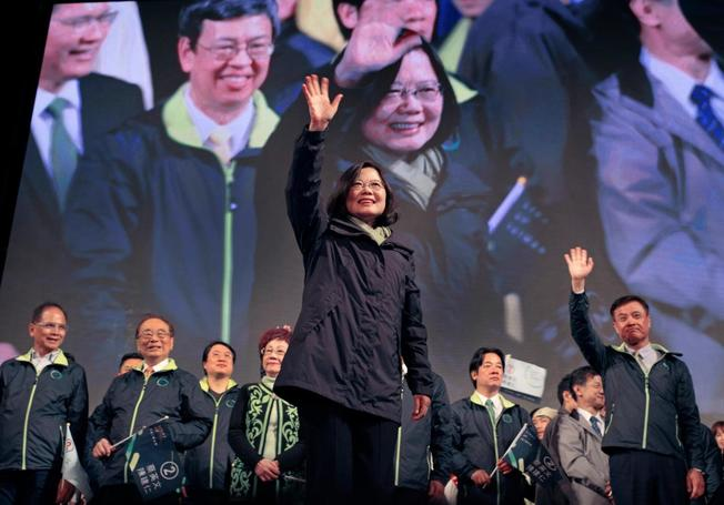 Taiwan's Democratic Progressive Party, DPP, presidential candidate, Tsai Ing-wen, raises her hands as she declares victory in the presidential election Saturday, Jan. 16, 2016, in Taipei, Taiwan. (AP Photo/Vincent Yu)
