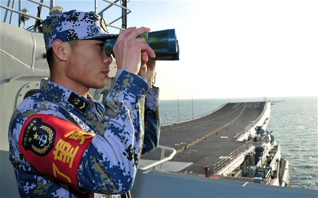 A Chinese naval soldier onboard the Chinese People's Liberation Army first aircraft carrier 'Liaoning'. Photo: Reuters