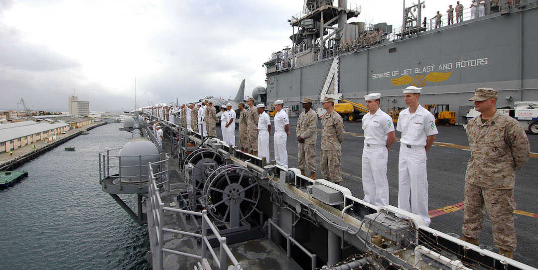 Sailors and Marines aboard the amphibious assault ship USS Boxer (LHD 4) man the rails as the ship pulls into Fremantle, Australia, for a port visit during their Western Pacific deployment