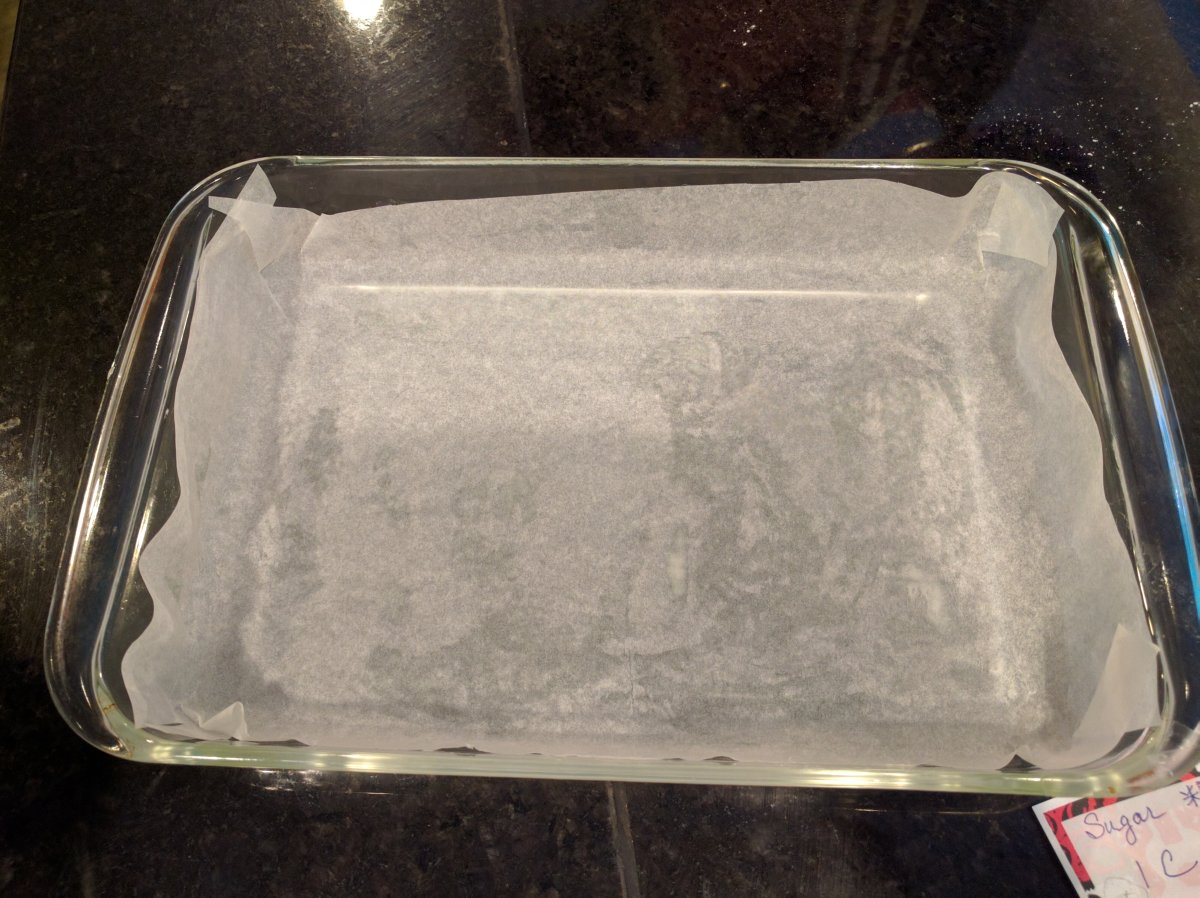 Line a 13x9 pan with foil or parchment paper. Putting some butter underneath will help keep it in place.