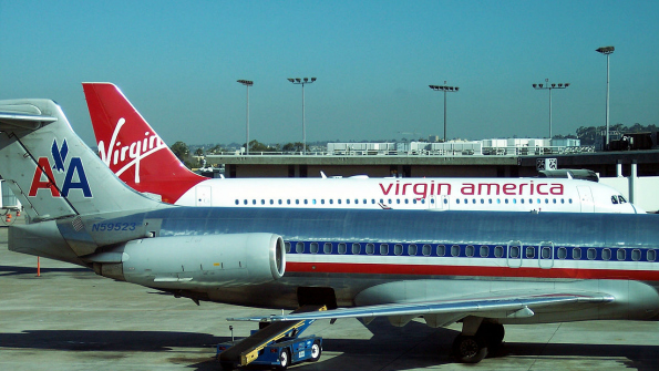 1280px-aa_and_virgin_america_in_sandiego_airport_crop.png