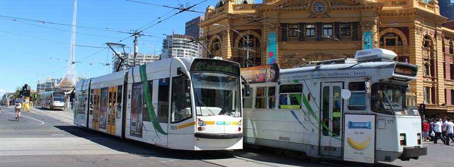 Trams-passing-Flinders-Street-(full-page).jpg