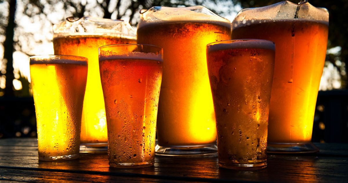 Pitchers_and_pints_of_cold_beer_seen_on_a_bar.jpg