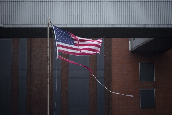 Tattered US flag flies in wake of this week's superstorm (ANDREW KELLY/REUTERS)
