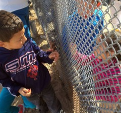 Families reunite at US-Mexico border fence: 'We touch hands, but it is like being in jail'