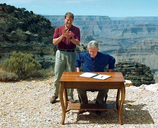 Al Gore applauds President Bill Clinton while in Arizona as he designates nearly 2 million acres in southern Utah a national monument