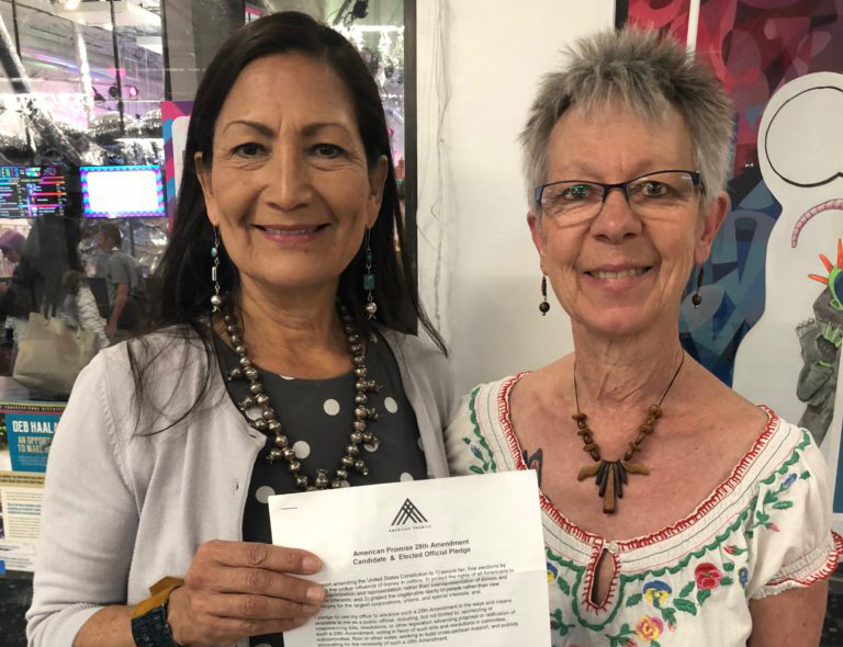 Ishwari Sollohub (right) with Deb Haaland (left) candidate for New Mexico's first congressional district. Haaland signed the 28th amendment pledge.