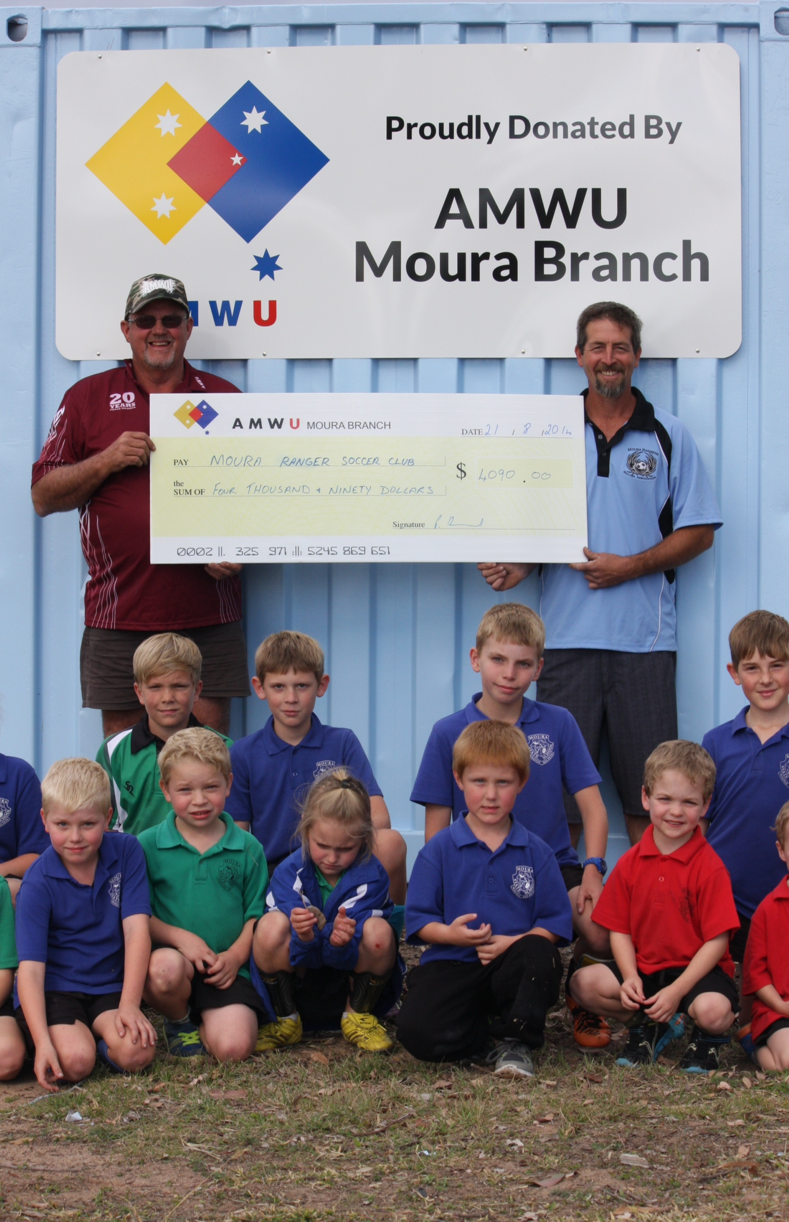 Moura Members Pitch in for Kids' Soccer