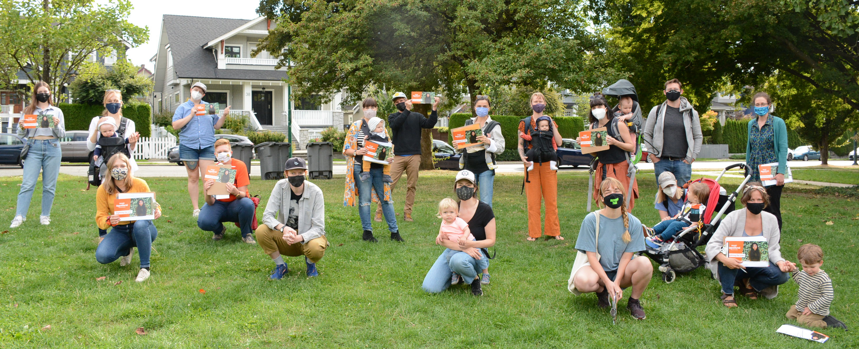 Parents and babies in a park getting ready to canvass for Anjali
