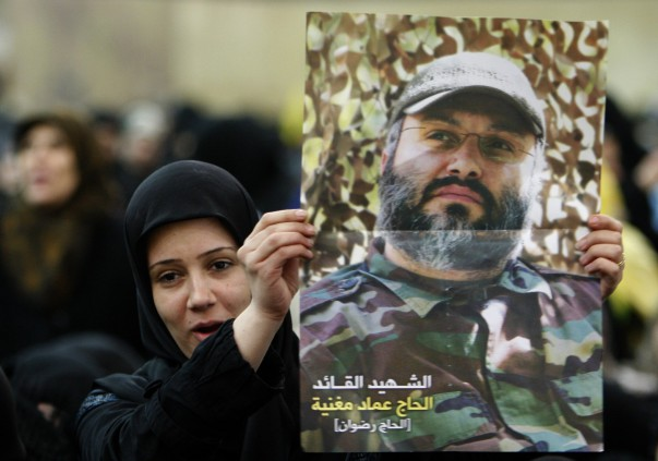 Woman-holds-poster-of-Imad-Mughniyah-e1423077639857.jpg