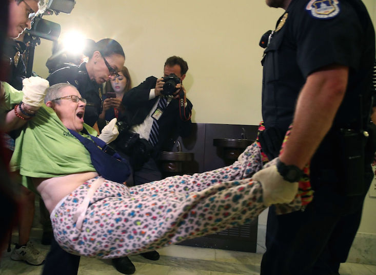 protester-disabled-capitol-police-health-care.jpg
