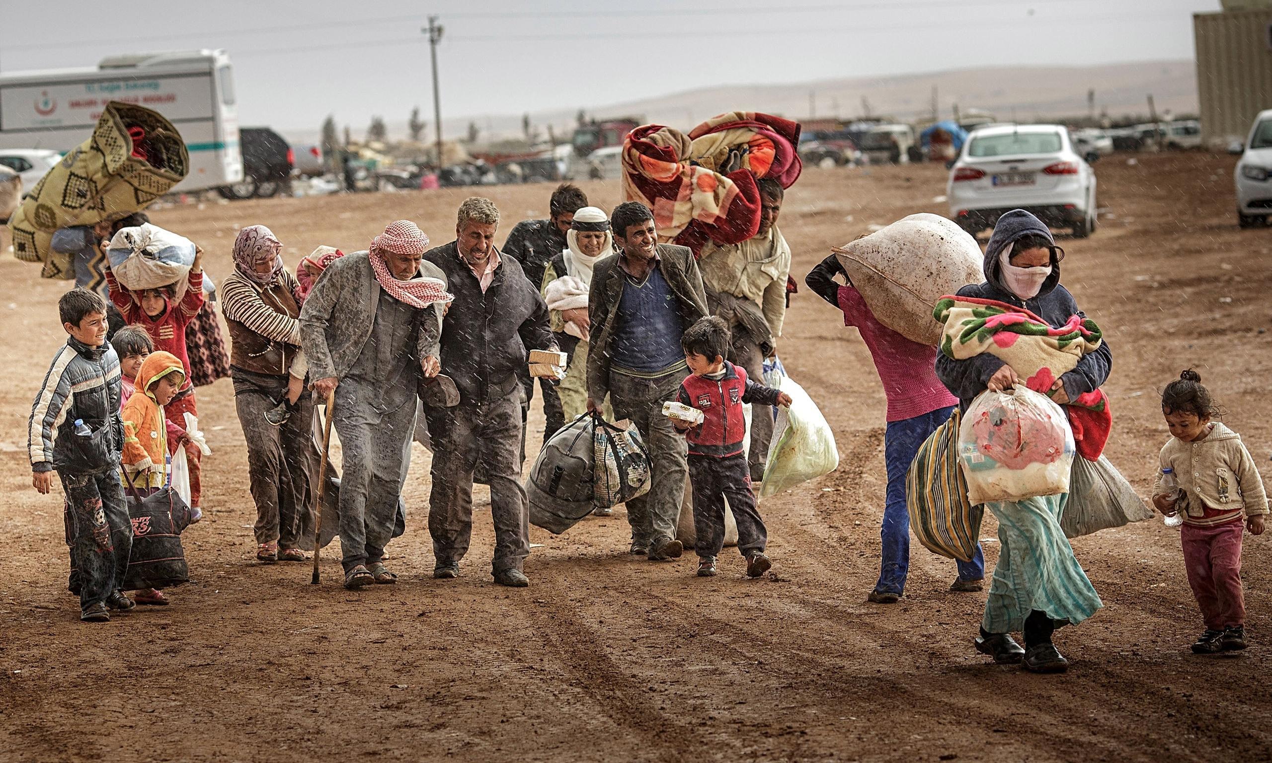 SyrianRefugeesReturningHome.jpg