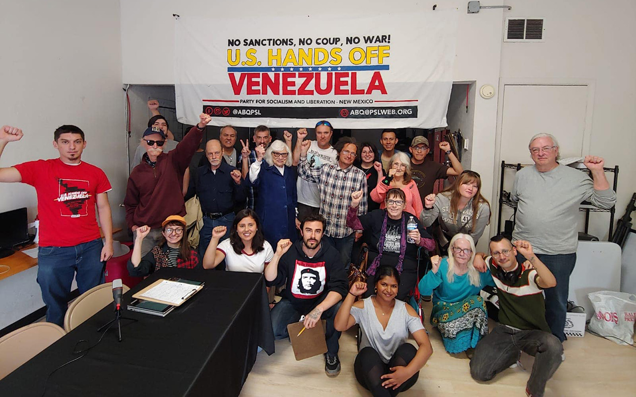 2019.05.19_answer_us_hands_off_venezuela_coalition_meeting_group_banner_cropped.jpg