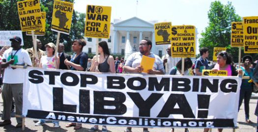 Major event at answer coalition buoyed by what they cite as reports from military analysts as well as rebel forces in libya hundreds of protestors organized by the international answer sciox Choice Image