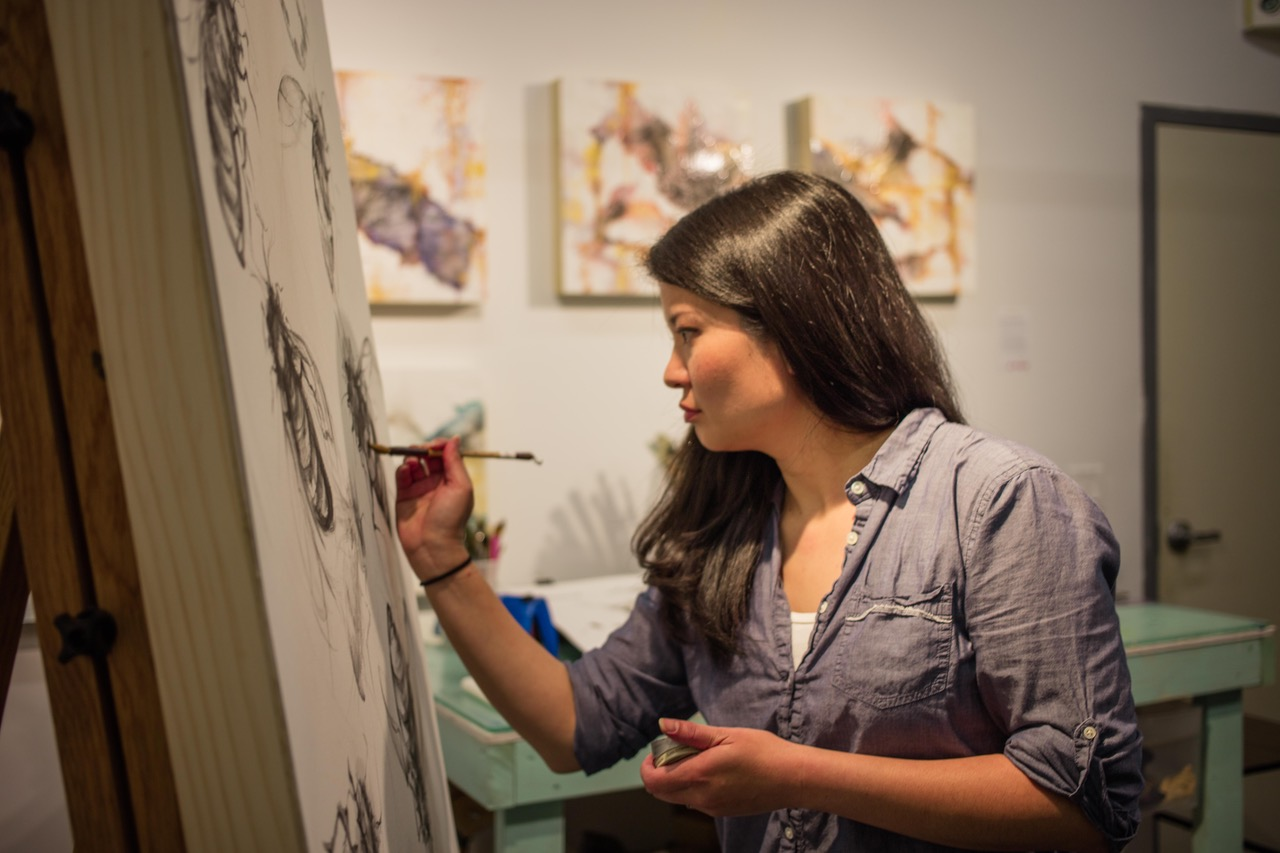 Artist Cindy Shih paints in her studio.