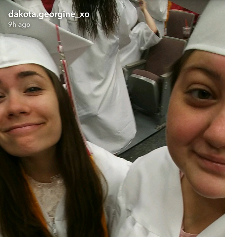 Dakota_Cap_and_gown_selfie.png