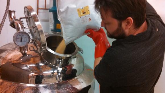 Steve Gertman pouring grain