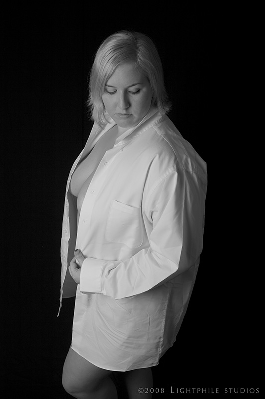 black and white portrait of a cis female in a white unbuttoned dress shirt