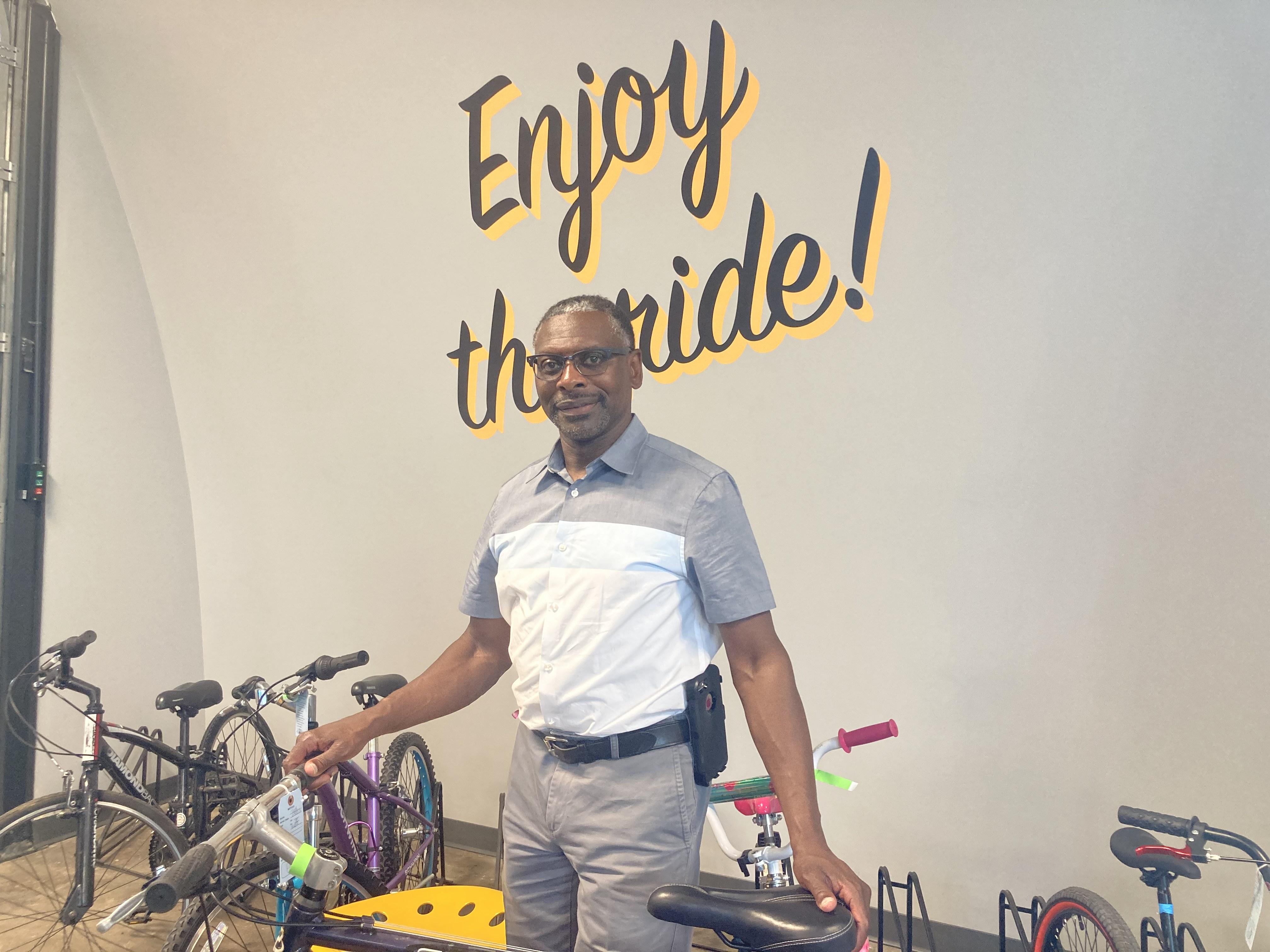 Alton West picks up his grandchildren's bikes from Bearings Bike Works