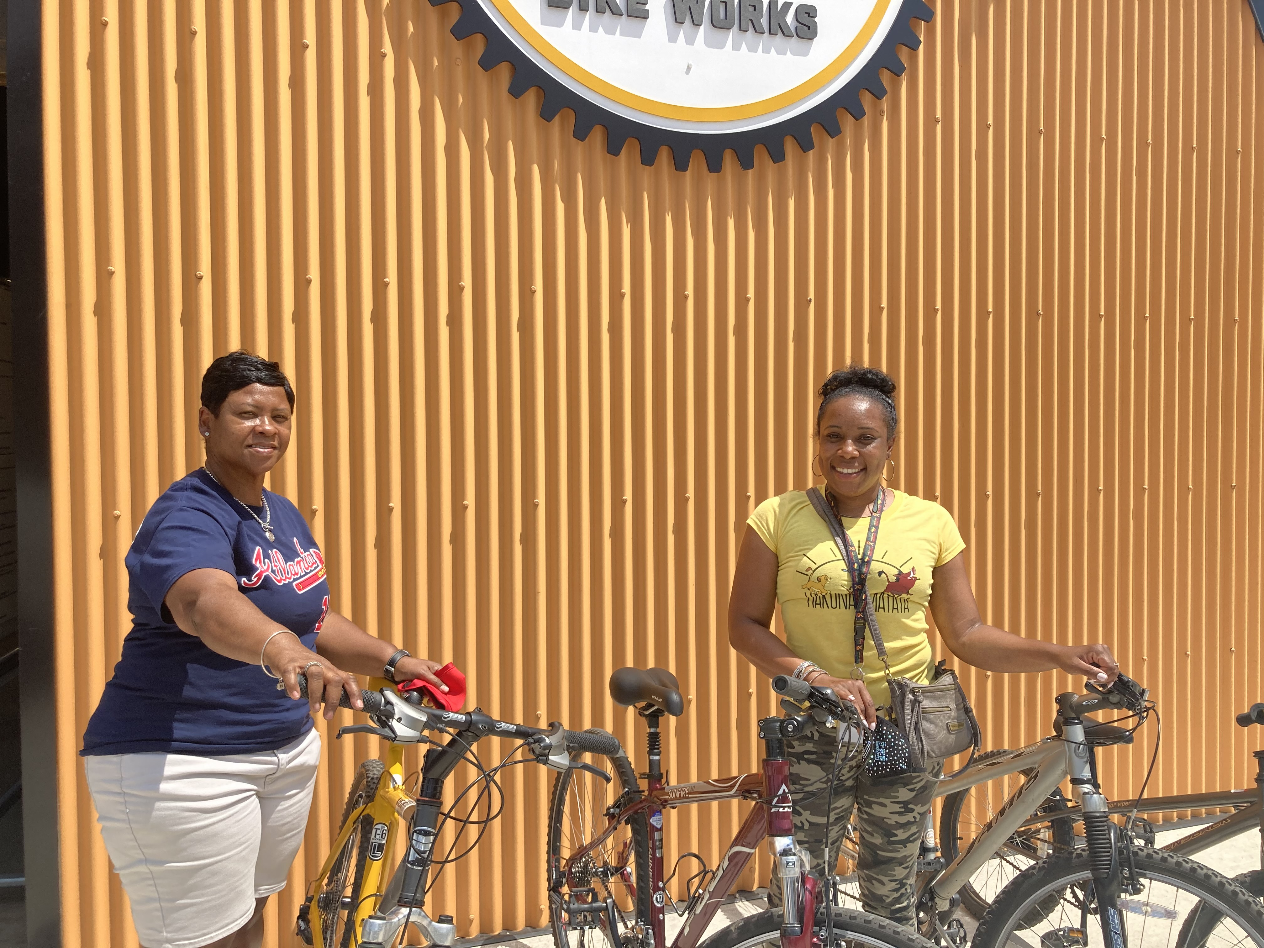 Dr. Hill and Coach Johnson picking up bikes from Bearings Bike Works