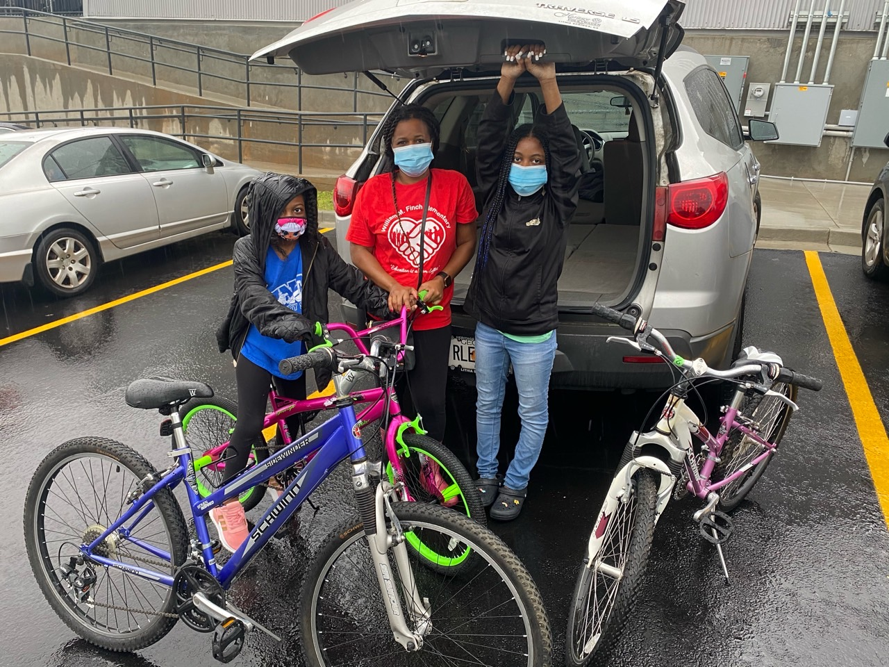Bike Family family and participants pick up bikes from Bearings Bikes