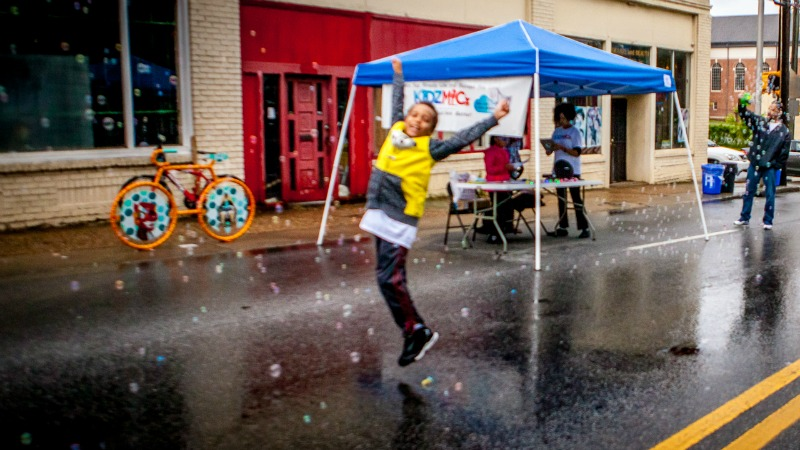 Photo: Kid jumping in the rain at Atlanta Streets Alive: Southside 2017 | Photo credit: Erik Voss