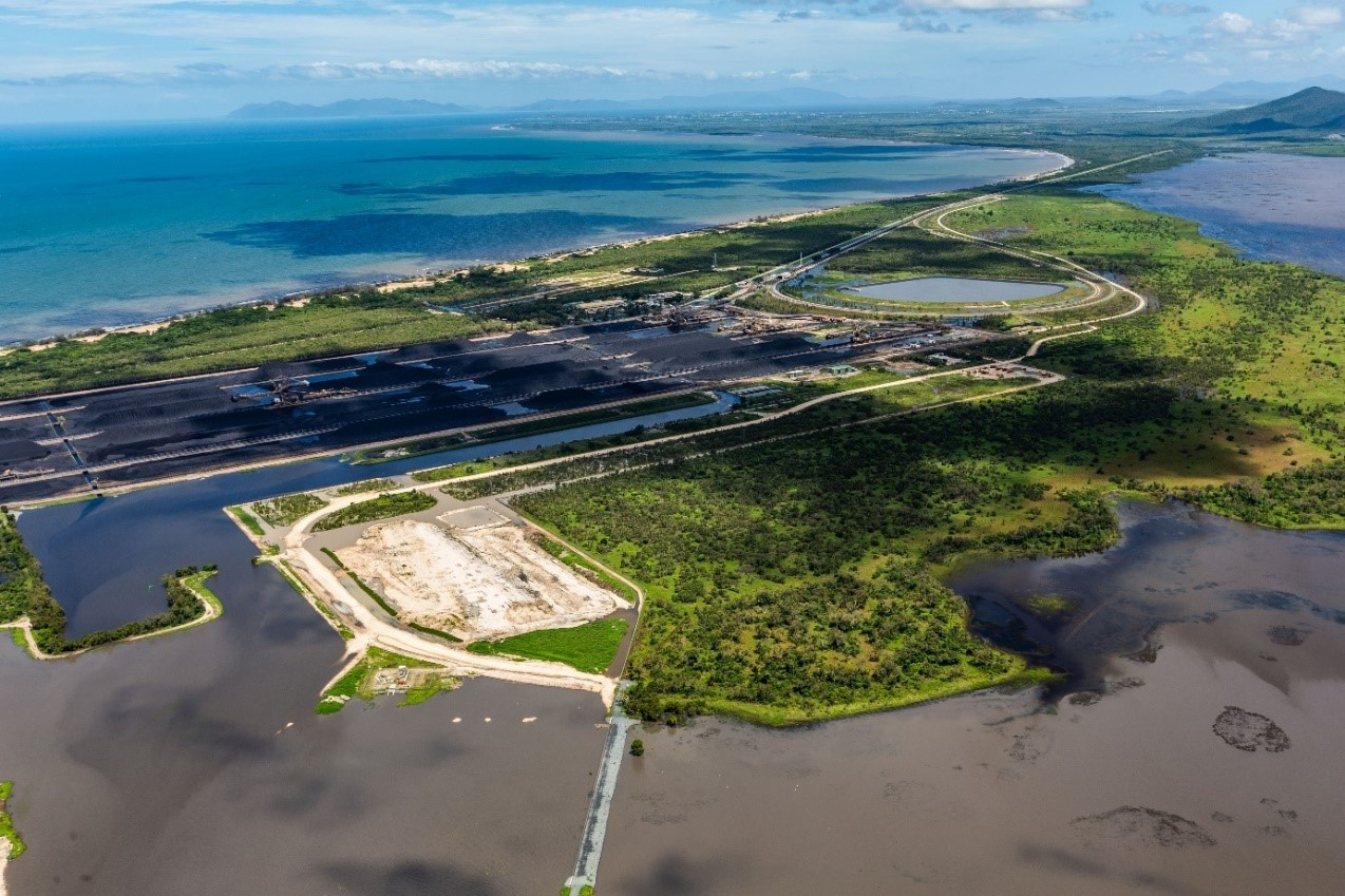 Coal stockpiles (middle distance) and discoloured water in settlement ponds (left foreground) and in the Caley Valley wetlands (right foreground), Abbot Point, 9 February 2019 (Pic: Gary Farr)