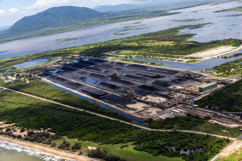 Coal stockpiles (middle distance) and discoloured water in settlement ponds (left foreground) and in the Caley Valley wetlands (right foreground), Abbot Point, 9 February 2019