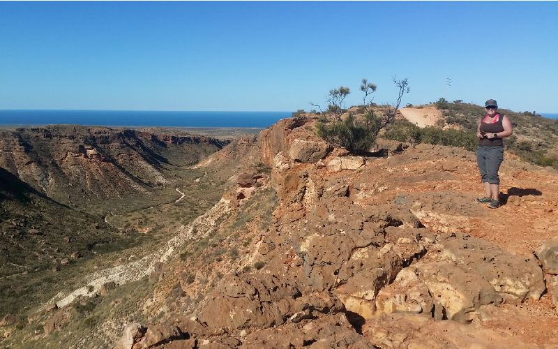 CEO Kelly O'Shanassy on top of mountain in Coral Coast, Western Australia