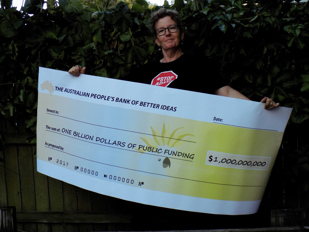 Sharon with the big cheque for a billion dollars