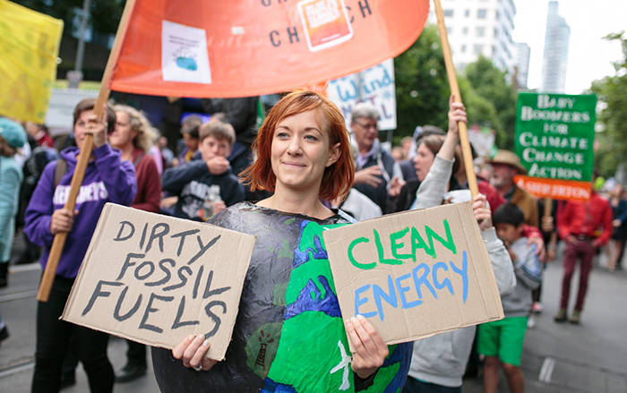 Woman holding signs in a climate march