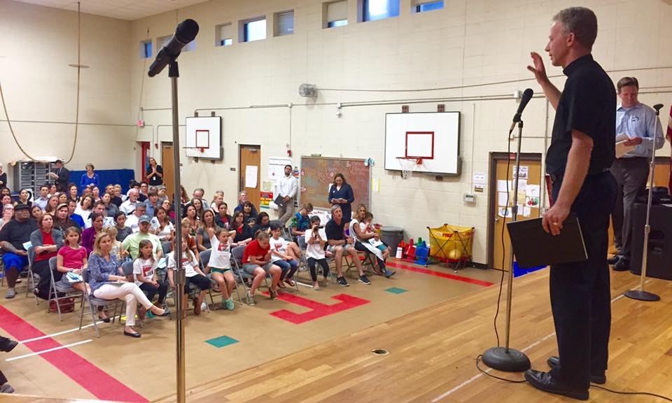 1605_-_ATX_-_Fr._Bill_Wack_at_Travis_Heights_Elementary_Assembly.jpg