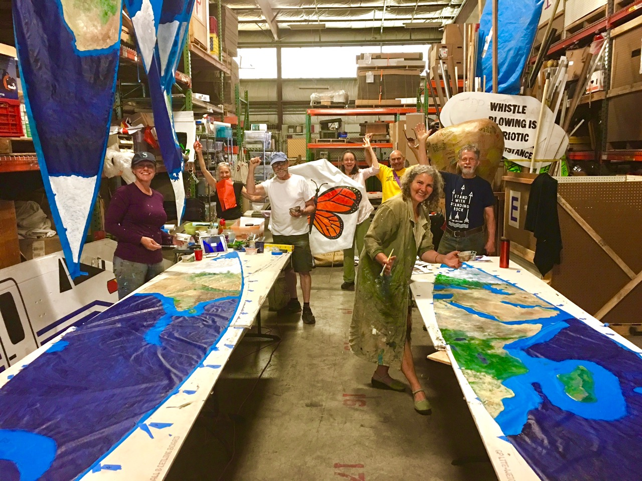 Small_Group_photo_in_the_warehouse_painting_the_globe_at_a_Wednesday_Volunteer_Drop-In_Art_build.jpg
