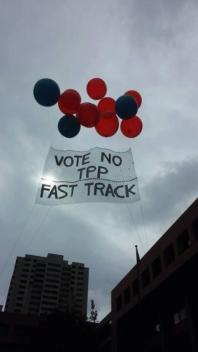 San_Diego_artful_activism_chris_mckay_fast_track_tpp_helium_balloon_banner.jpg