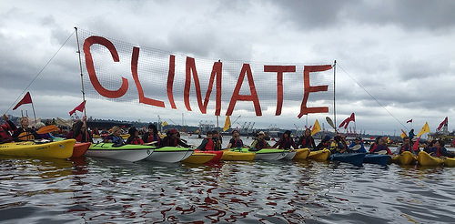 Margo_Polley_Climate_Raft_Up_paddle_in_seattle_500px_23731290530_8d3e18b6c6.jpg