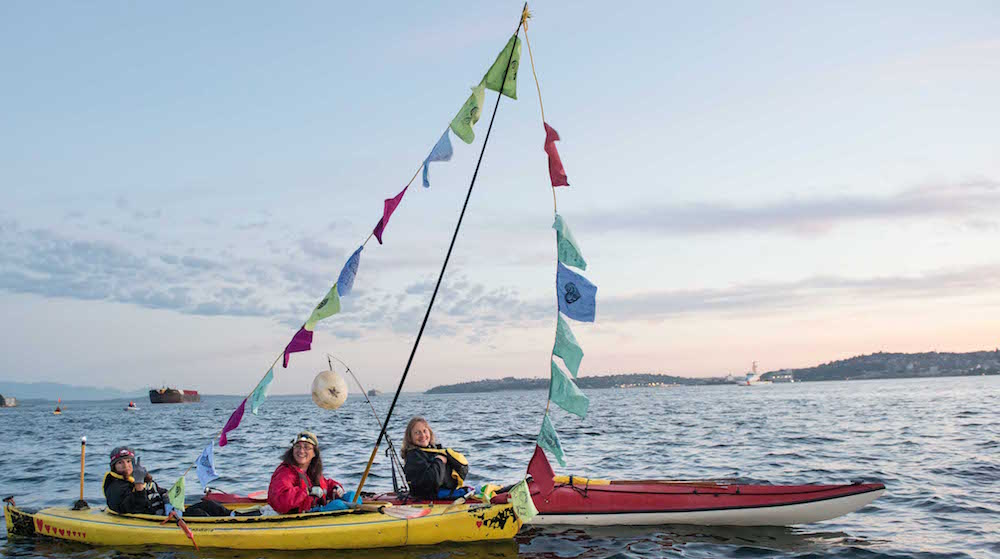 1000_px_Small_Cropped_Lisa_Denise_Lauren_Prayer_Flags_in_kayaks_during_Polar_Pioneer_Departure_Backbone_Shell_Arctic_Blockade_(172_of_584)_copy.jpg