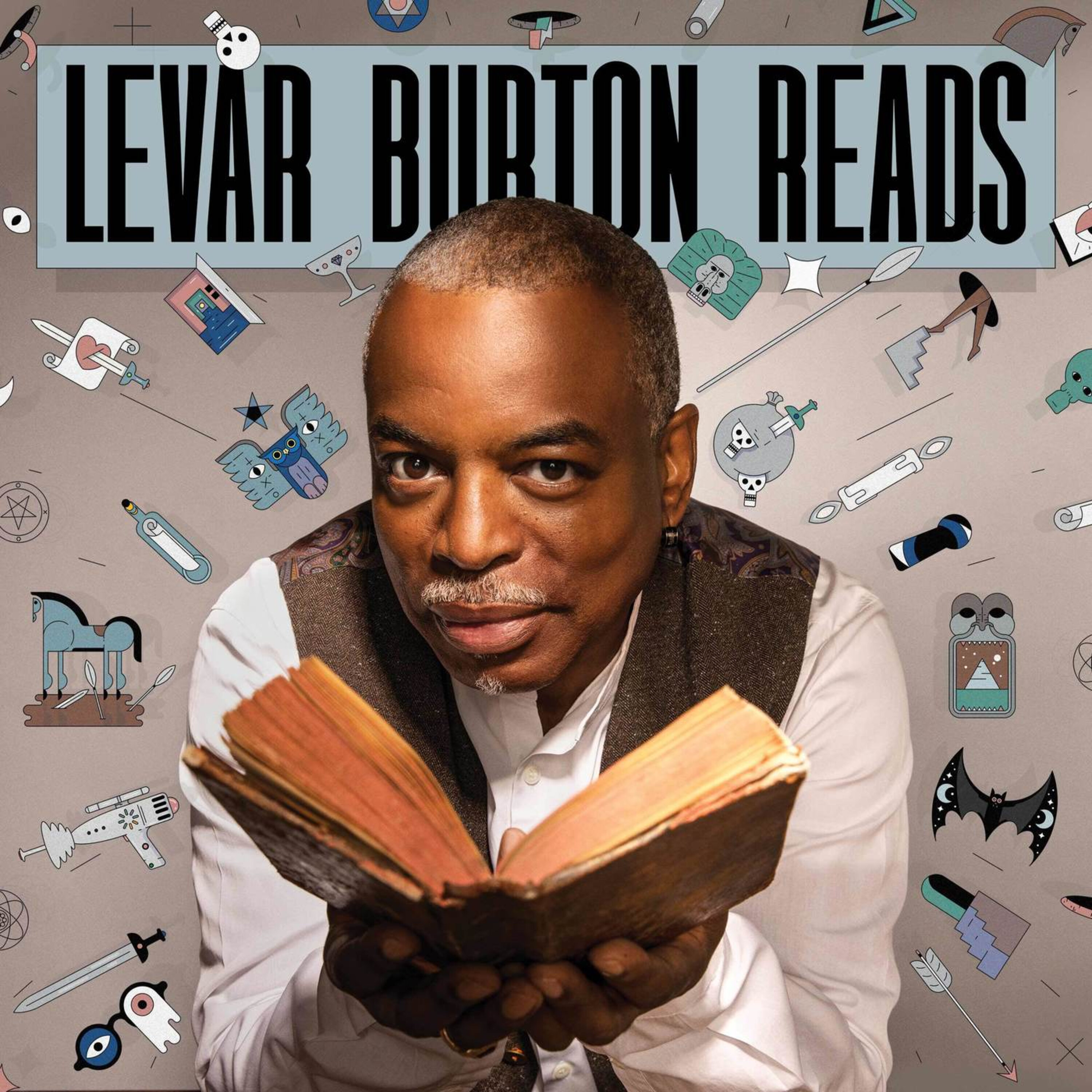 Image of LeVar Burton holding open a book with a gray background.