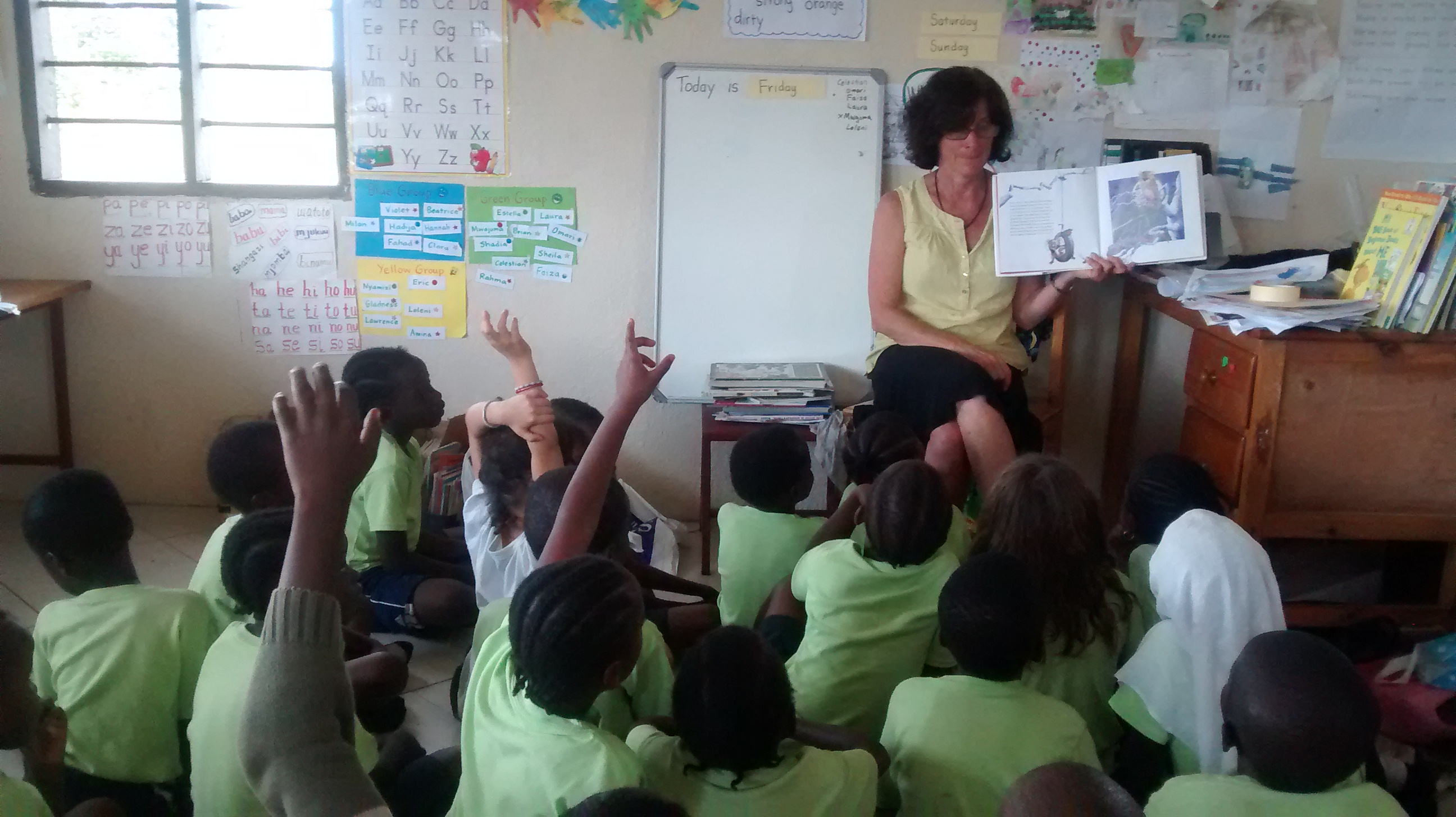 Debbie_reading_with_junior_kids.jpg