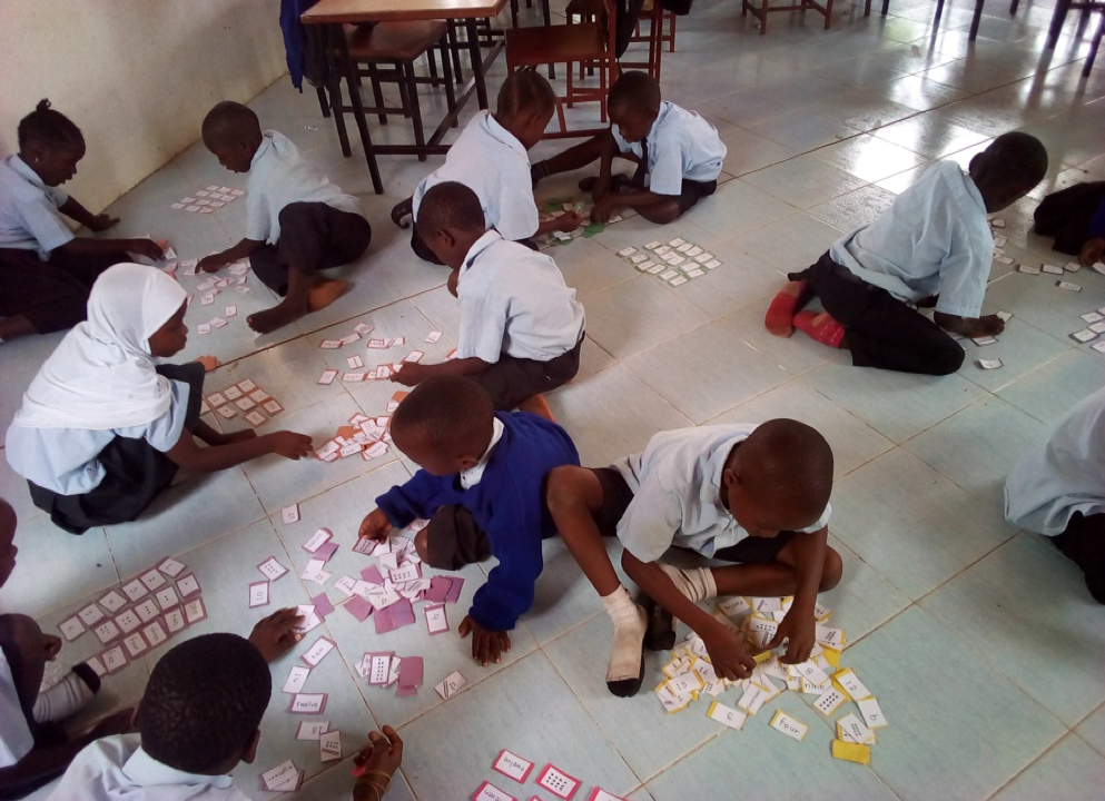 Students playing and learning in classroom