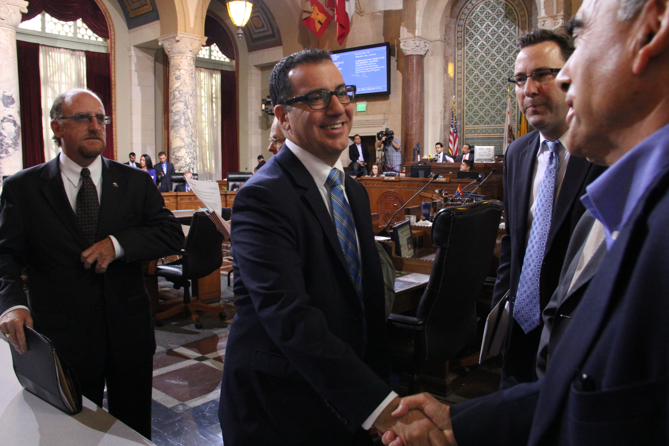 Councilmember Blumenfield shakes hands with Jacob Segal of the Southern California Israel Chamber of Commerce (SCICC), following the unanimous vote in favor of establishing the Los Angeles/Eilat Innovation and Cooperation Task Force, May 23, 2014.