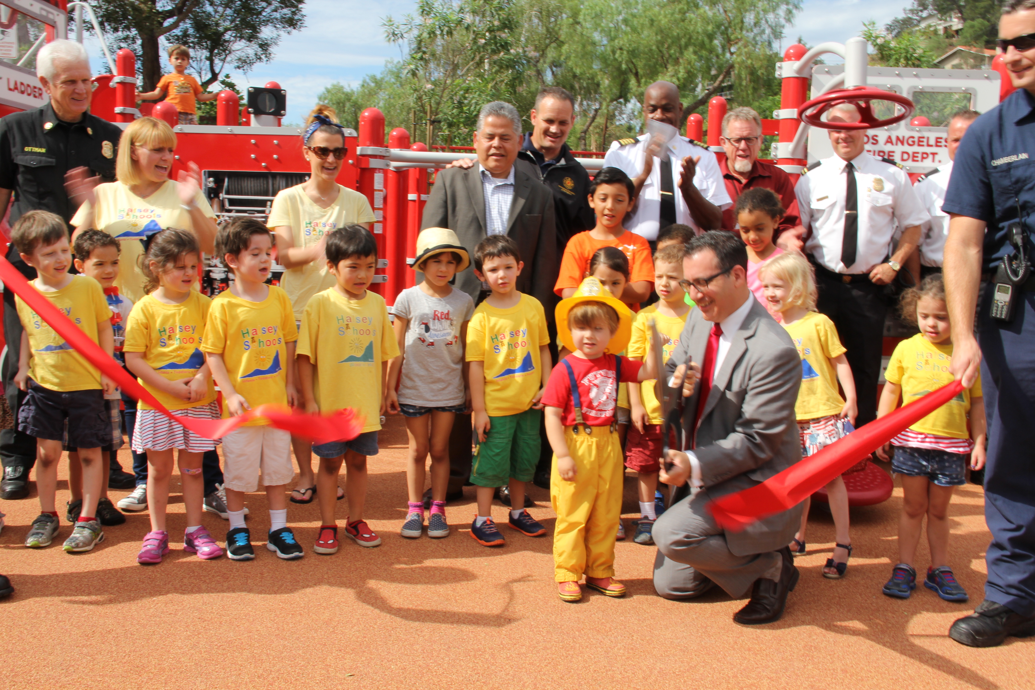 Blumenfield is joined by Recreation and Parks officials, LAFD Firefighters and dozens of neighbors and local kids to cut the ribbon on the new Costanso Fire Station 84 Park, on July 2, 2015.