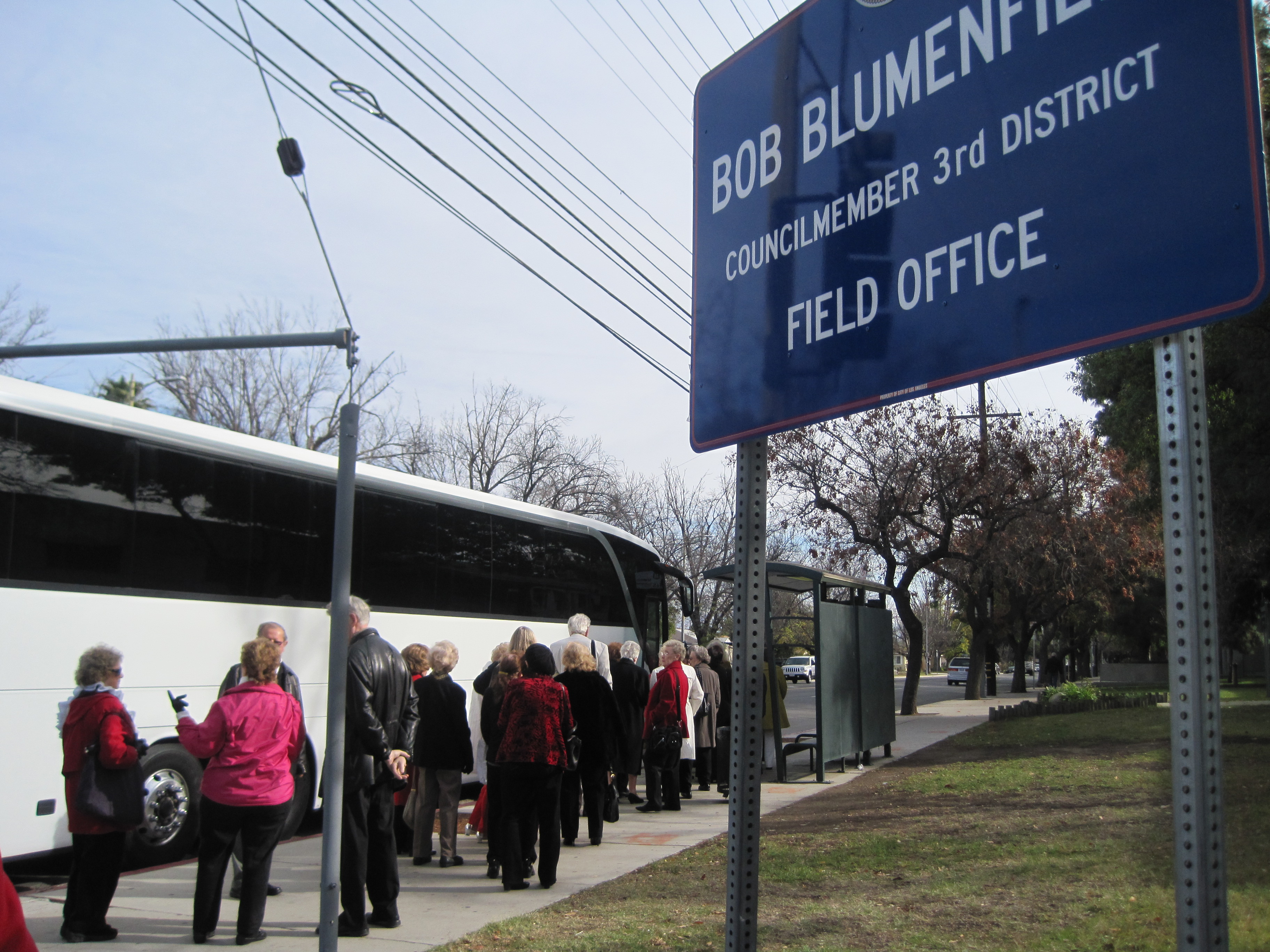 Members of St. Mel Catholic Church in Woodland Hills board a bus bound for the Candlelight Pavilion in Claremont