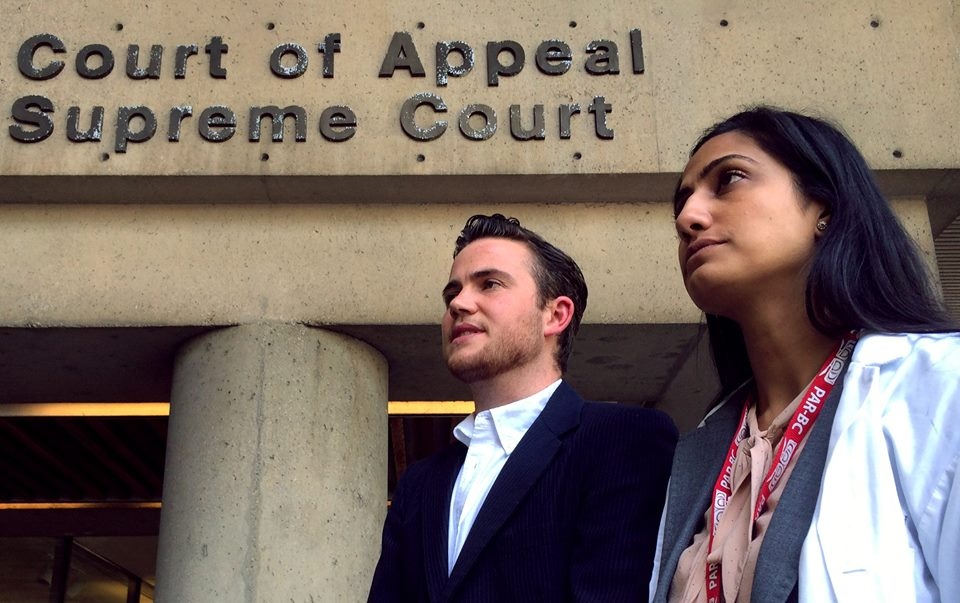 Adam and Rupi at court