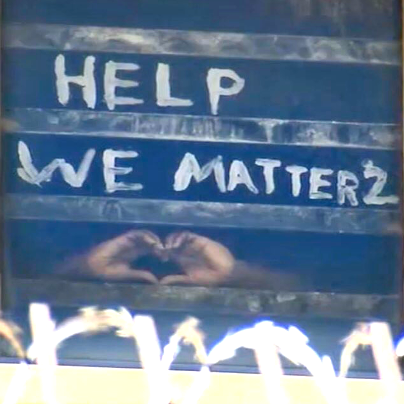 Detainee scrawled Help We Matter2 on window with hands in heart shape - Cook County Jail
