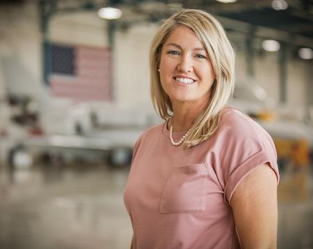 Beth_Pink_shirt_smiling_flag_in_back-2.jpg