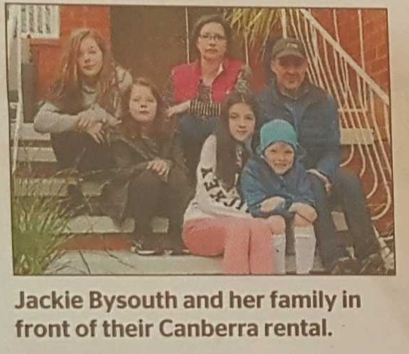 A photo from the Canberra Times of a renter with their family