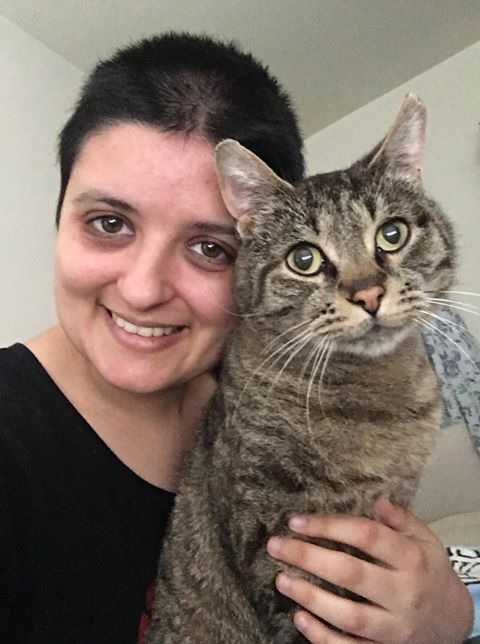 A picture of a renter with their pet cat