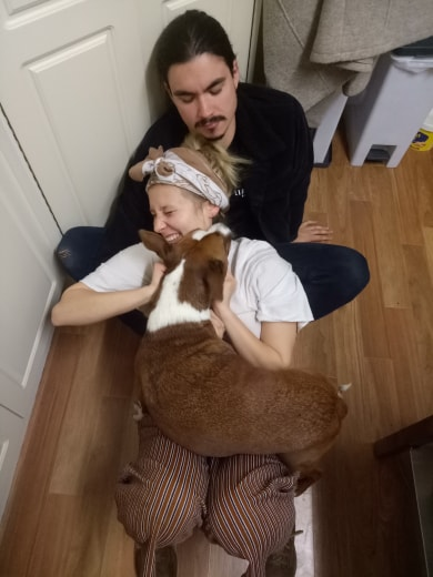 A picture of a renting couple with their pet dog